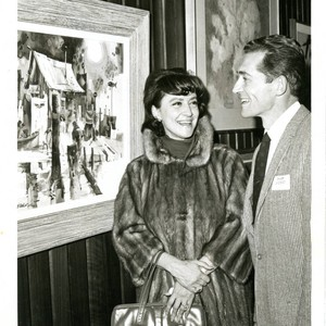 Bob Wood and woman at an art exhibit, mid 1960s