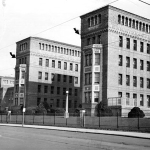 [Exterior view of San Francisco General Hospital with artist arrows added]