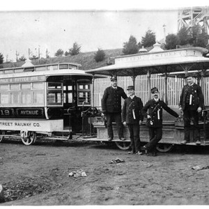 [Sutter Street Railway Company employees posing in front of cable cars]