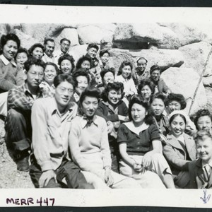 Photograph of a group of people, including Bernice Sibner, sitting on rocks ...