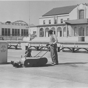 Santa Monica City worker operates a mechanical sweeper in front of the ...