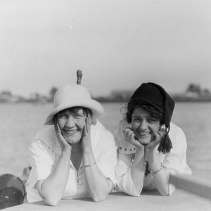 Two smiling women posing at the beach