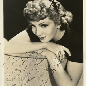 Headshot of Claudette Colbert with dedication to Micky Moore