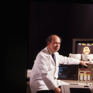 Images for the 1987 Annual report, Dr. Buchsbaum in a science lab.