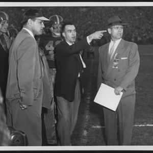 University of Southern California football coaches Hill, Broadbent, and Muha coaching the ...