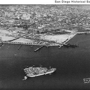 Aerial view of ships tied together in San Diego Bay, looking northeast ...