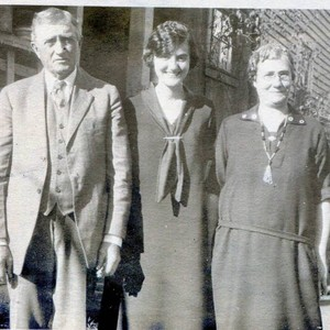 Three unidentified family members, probably father, mother and adult daughter