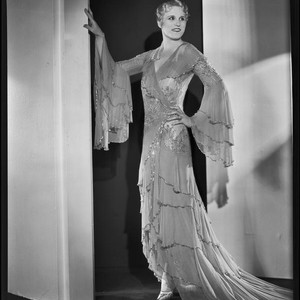 Peggy Hamilton modeling a Travis Banton hostess gown with beaded chiffon and ...