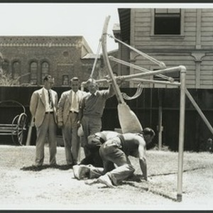 University of Southern California football coaches watch while two men try out ...