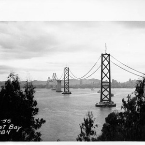 [View of catwalk of San Francisco-Oakland Bay Bridge stretched out over the ...