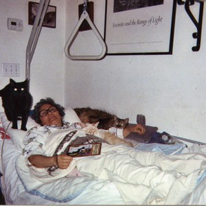 Patricia Whiting in bed with her cats