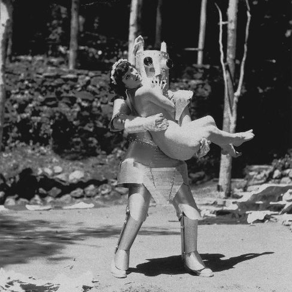 Calisphere: A man dressed as a robot holding a naked woman at the ...